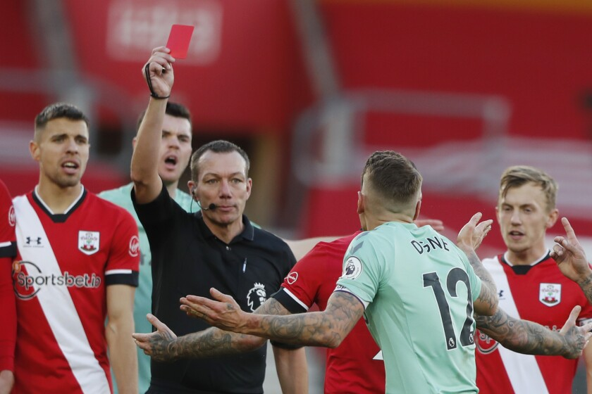 Everton's Lucas Digne, centre right, is shown a red card by the referee after a foul on Southampton's Kyle Walker-Peters during an English Premier League soccer match between Southampton and Everton at the St. Mary's stadium in Southampton, England, Sunday Oct. 25, 2020. (AP Photo/Frank Augstein, Pool)