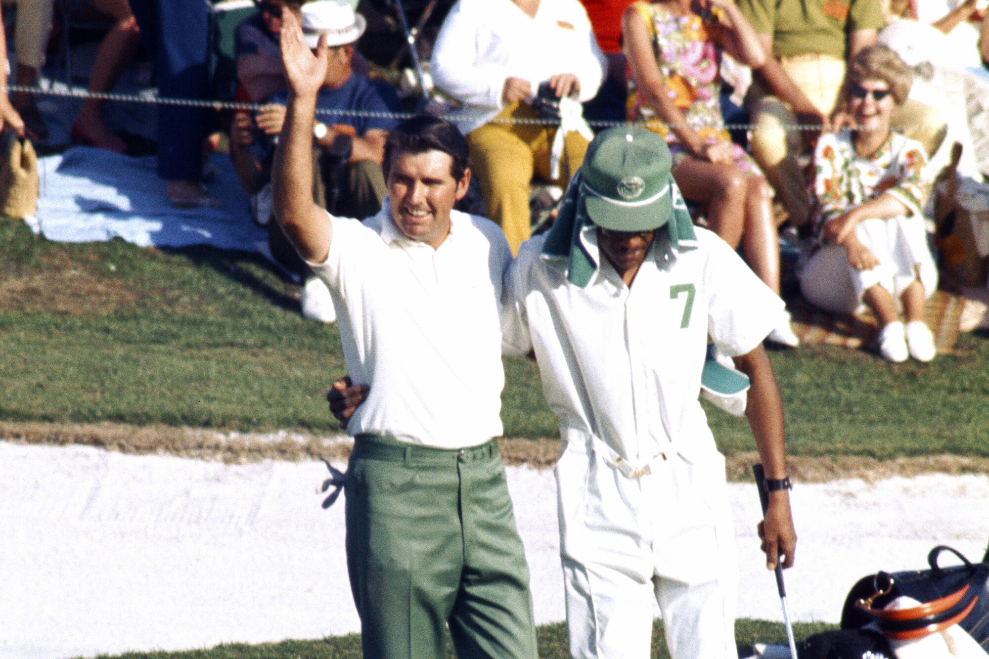 Charles Coody and caddie Walter Pritchett react to victory during the 1971 Masters.