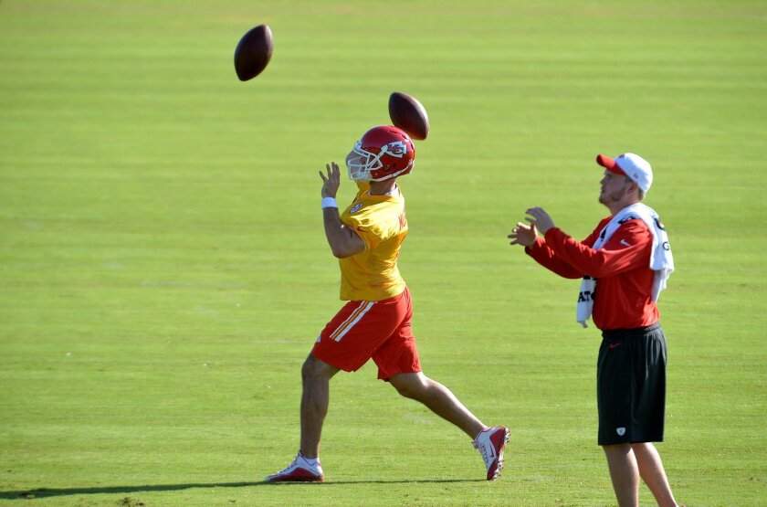 Kansas City Chiefs quarterback Aaron Murray throws passes during an NFL football training camp practice Thursday, July 30, 2015, in St. Joseph, Mo. (Andrew Carpenean/The St. Joseph News-Press via AP) MANDATORY CREDIT