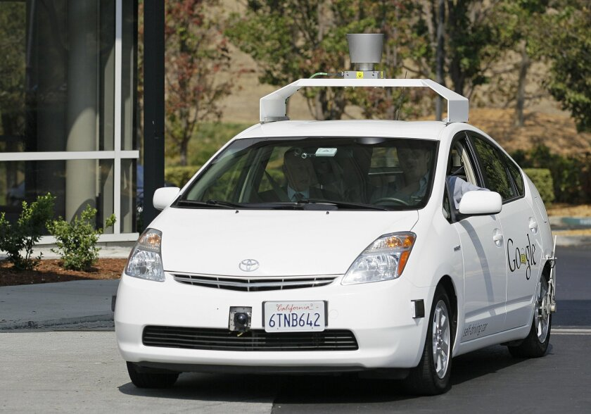 FILE - In this Sept. 25, 2012, file photo, California Gov. Jerry Brown, front left, rides in a driverless car to a bill signing at Google headquarters in Mountain View, Calif. California state officials on Thursday, June 18, 2015 released reports detailing six accidents that involved self-driving c