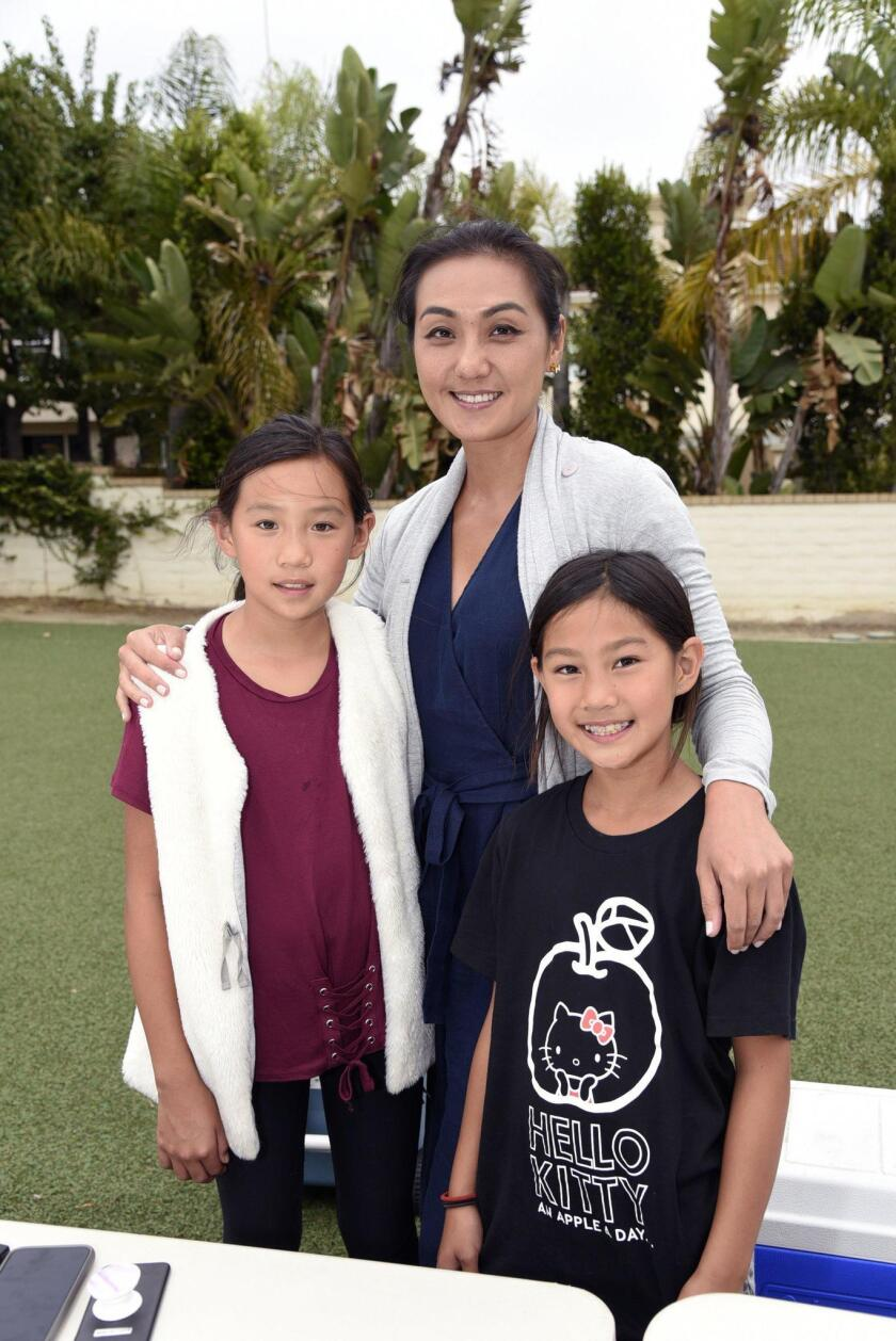 PTA President Jenny Hong with Isabelle and Madeleine