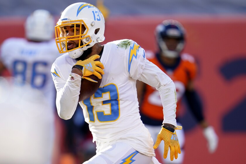 Los Angeles Chargers wide receiver Keenan Allen (13) scores a touchdown against the Denver Broncos during the first half of an NFL football game, Sunday, Nov. 1, 2020, in Denver. (AP Photo/David Zalubowski)