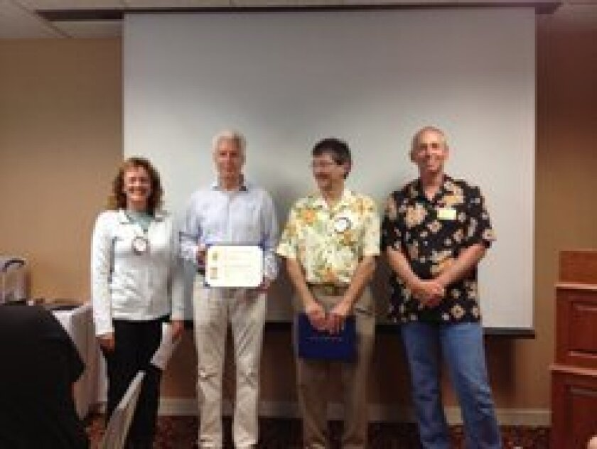 Paul Harris Fellows: L-R, Foundation Chair Susan Hennenfent, Eric Erickson, Greg Einhorn, President Kirk Collins