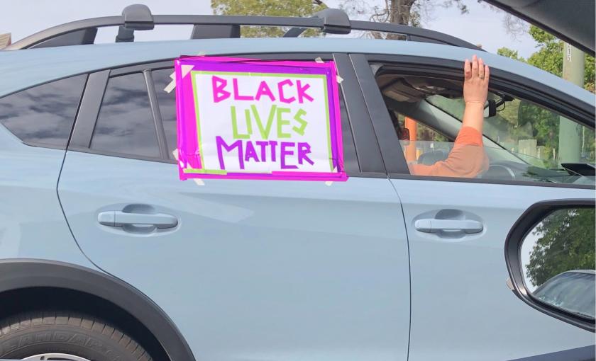 A car participates in a caravan protest Sunday in Oakland.
