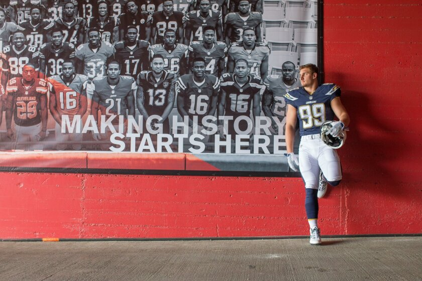Joey Bosa leans on a wall next to the 2015 Rookie Premiere team picture at the Los Angeles Memorial Coliseum during the NFLPA Rookie Premiere on May 21.