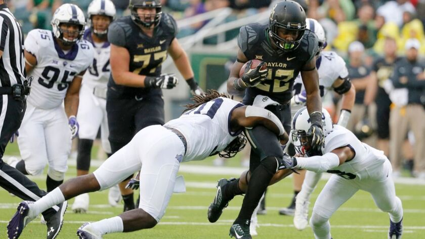 TCU safety Denzel Johnson (30) and safety Nick Orr, right, combine to stop Baylor running back Terence Williams (22) after a short run in the first half on Nov. 5, 2016.