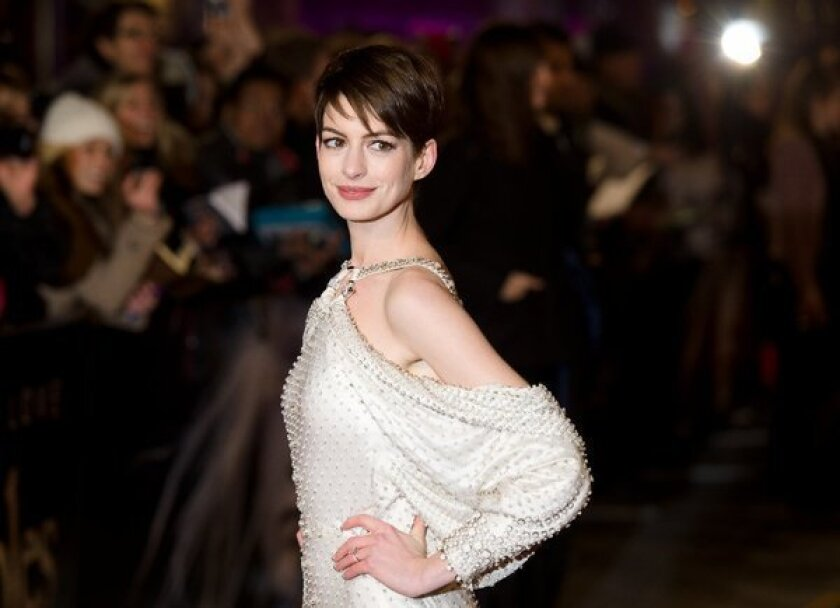 """Anne Hathaway discusses her car-exiting wardrobe malfunction with """"Today"""" show anchor Matt Lauer. Here she's seen at the London premiere of """"Les Miserables"""" on Dec. 5."""