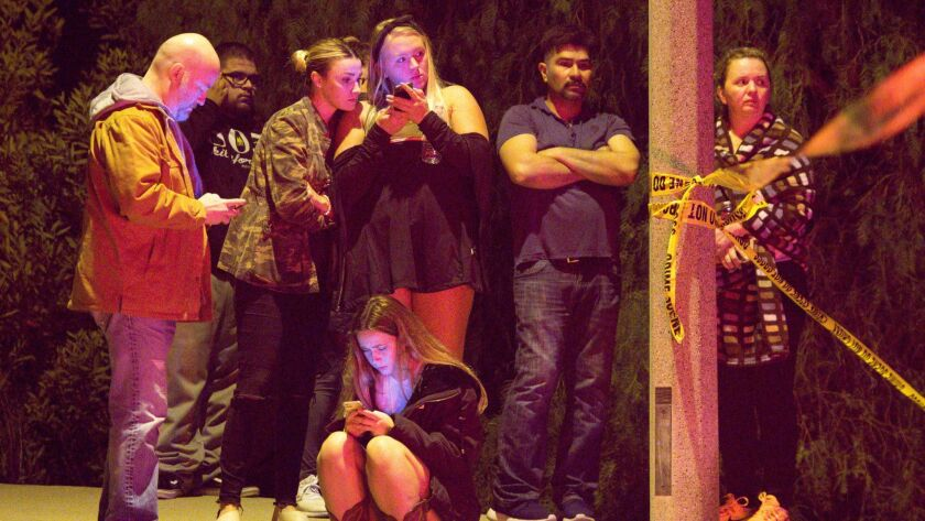 Friends and family members wait for news following a mass shooting that left multiple casualties at Borderline Bar & Grill.