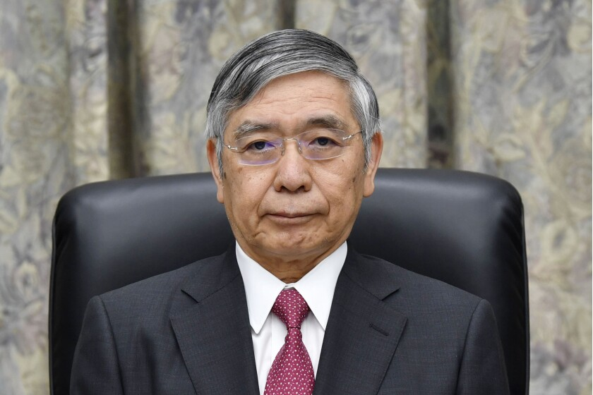 Bank of Japan Gov. Haruhiko Kuroda attends a meeting at its headquarters in Tokyo Thursday, Sept. 19, 2019. Japan's central bank has opted to keep its monetary policy unchanged despite growing signs of trouble that prompted the Federal Reserve to cut its benchmark rate. (Muneyuki Tomori/Kyodo News via AP)