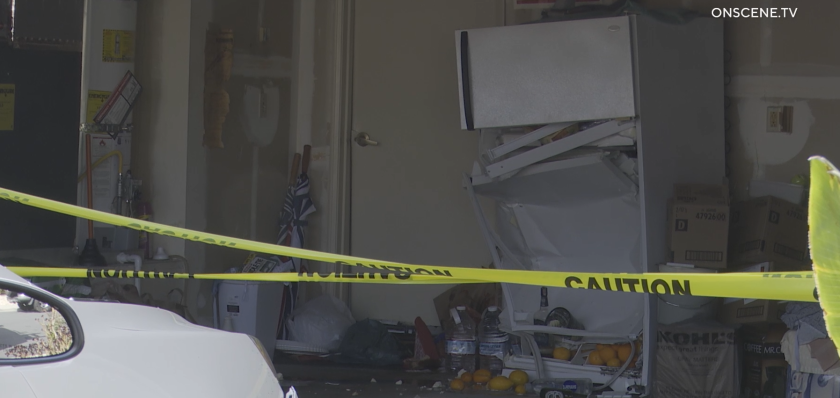 A 91-year-old driver backed into his neighbor's home and then slammed into his own garage.