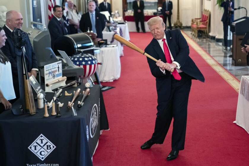 President Donald Trump swings a baseball bat during the Spirit of America Showcase at the White House, Thursday, July 2, 2020, in Washington. (AP Photo/Evan Vucci)