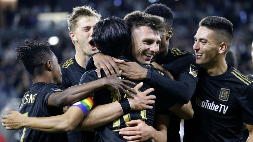 Los Angeles FC defender Tristan Blackmon, third from right, celebrates his goal with teammates durin