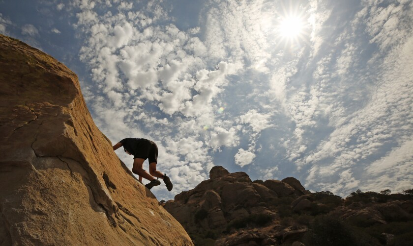 Josh Puchalski practices his bouldering skills at Stoney Point Park.