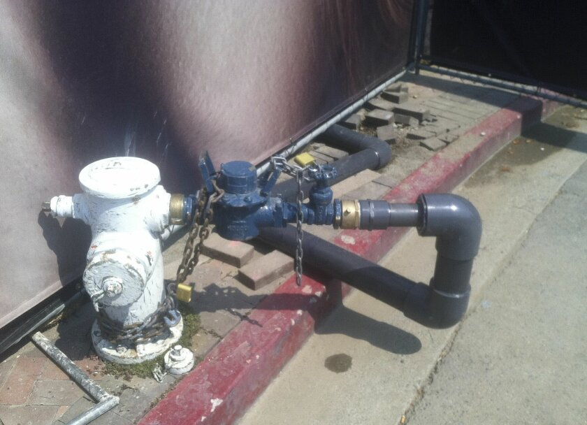In this undated photo provided by the East Bay Municipal Utility District, a hydrant meter has been permanently mounted and padlocked by a water thief. Northern California water districts are looking to hike fines for meter cheaters and other people who steal water as the state enters its fourth year of drought. The East Bay Municipal Utility District and some other San Francisco Bay Area water districts have never issued such fines. Instead, repeat offenders have had their water turned off and charged reconnection fees. (AP Photo/East Bay Municipal Utility District)