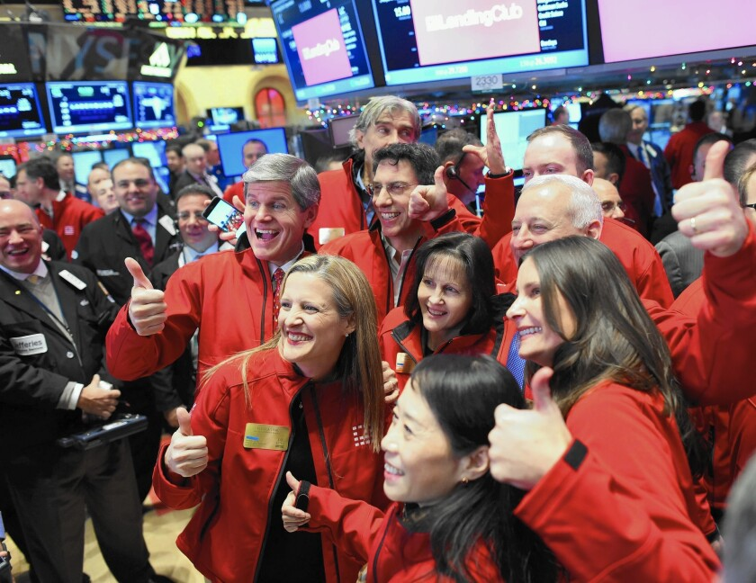 Lending Club executives gather on the floor of the New York Stock Exchange for the company's IPO.