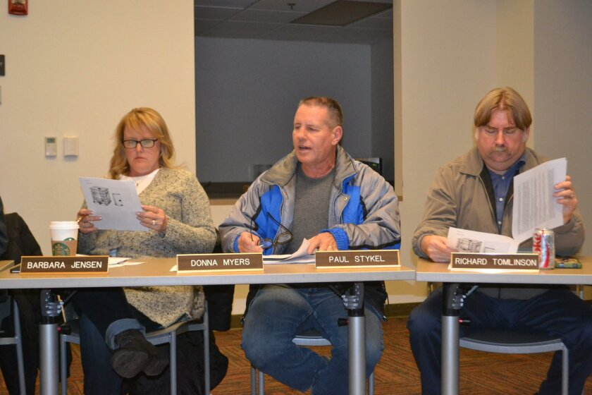 Paul Stykel, center, presents the winery subcommittee's report on the county's draft changes to the Tiered Winery Ordinance. Stykel chaired the subcommittee. Reviewing the information are planners Barbara Jensen and Richard Tomlinson.