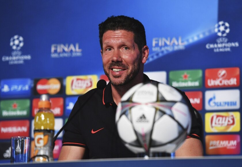 In this photo provided by UEFA Atletico Madrid's head coach Diego Simeone smiles during a press conference at the San Siro stadium in Milan, Italy, Friday, May 27, 2016. The Champions League final soccer match between Real Madrid and Atletico Madrid will be held at the San Siro stadium on Saturday,