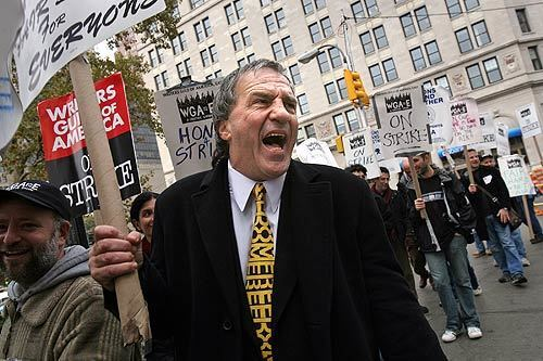 Richard Castellano, a member of the Screen Actors Guild, has been supporting the writers strike for a full week now. He joined the picket line at New York's financial district.