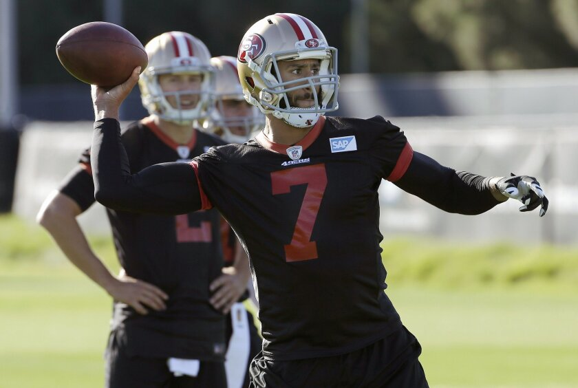 San Francisco 49ers quarterback Blaine Gabbert, rear, watches as quarterback Colin Kaepernick (7) passes during an NFL football practice in Santa Clara, Calif., Wednesday, Nov. 4, 2015. Head coach Jim Tomsula announced that the 49ers have officially made the change at quarterback from Kaepernick to