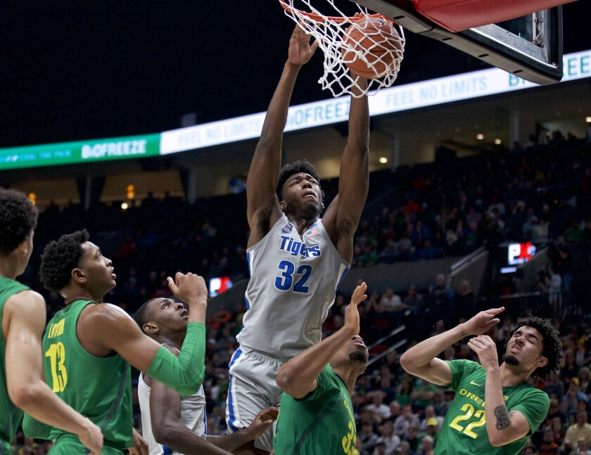 FILE - Memphis center James Wiseman (32) dunks against Oregon during the second half of an NCAA college basketball game in Portland, Ore., in this Tuesday, Nov. 12, 2019, file photo. At long last, James Wiseman is about to be on a team again. More than a year removed from the end of his three-game college career that was doomed almost before it started because of NCAA rulings regarding his eligibility, the 7-foot-1 left-hander will be one of the first players selected in Wednesday's, Nov. 18, 2020, NBA draft. It's hard to envision a scenario where he doesn't go in the first three picks, which are currently held by Minnesota, Golden State and Charlotte.(AP Photo/Craig Mitchelldyer, File)