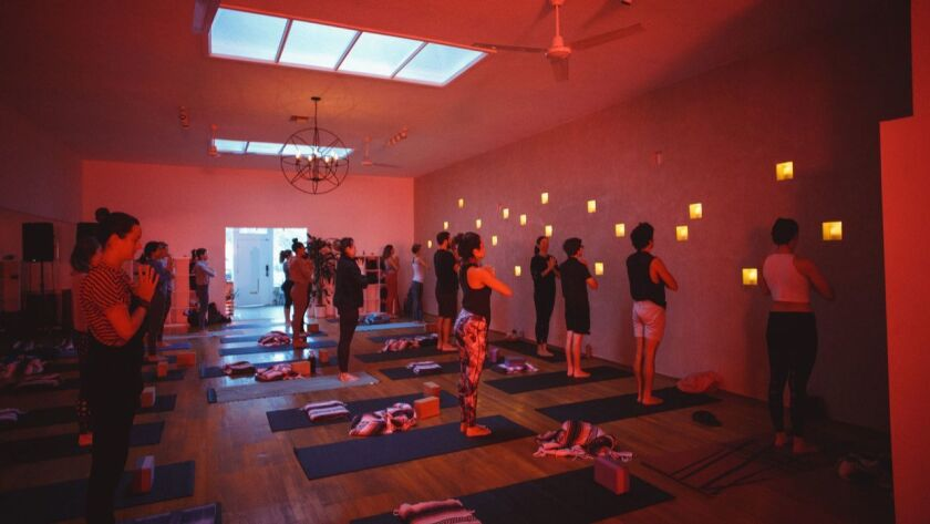 Monday's crack-of-dawn yoga session is designed to celebrate the new moon.