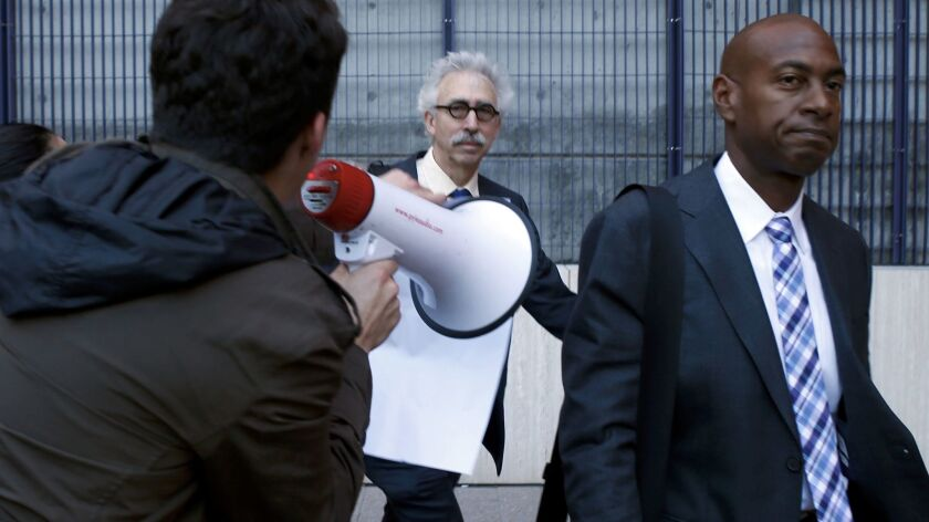 University of California chancellor Nicholas Dirks gets an earful from U.C. Berkeley student Giovanni D'ambrosia protesting proposed tuition hikes outside a regents meeting in San Francisco. (Karl Mondon/Bay Area News Group)
