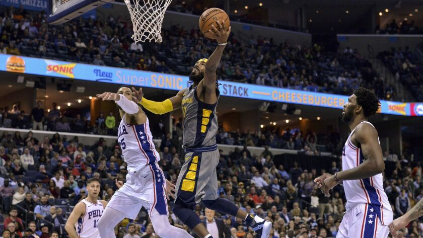 Memphis Grizzlies guard Mike Conley (11) drives for a layup against Philadelphia 76ers guard Ben Simmons (25) in the second half.