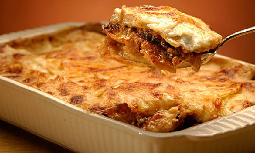 SIDE: Carmelized onions make the texture seem richer in this potato gratin with prosciutto.