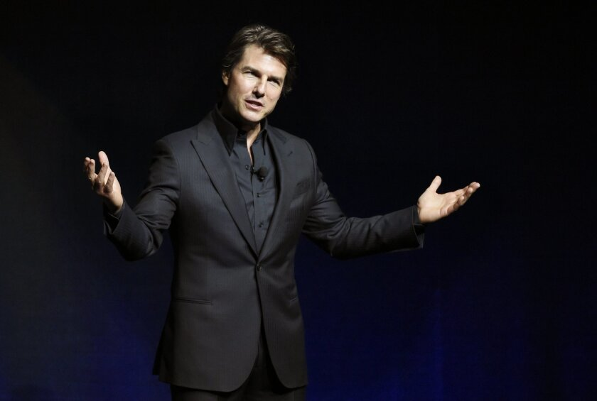 """Tom Cruise, star of the upcoming film """"Mission: Impossible: Rogue Nation,"""" addresses the audience during a surprise appearance at the Paramount Pictures presentation at CinemaCon 2015 at Caesars Palace on Tuesday, April 21, 2015, in Las Vegas. (Photo by Chris Pizzello/Invision/AP)"""