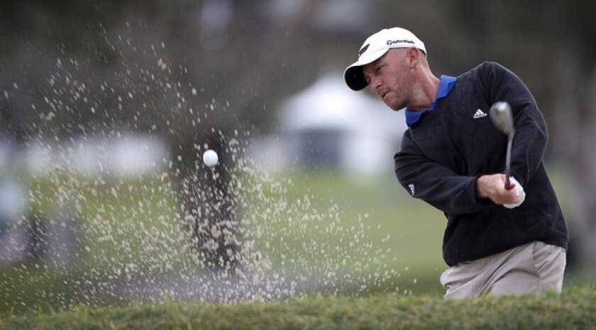 Jason Green hits out of the bunker on hole No. 4 on the North Course on Friday during the second round of the Buick Invitational at Torrey Pines. <em>John R. McCutchen/Union-Tribune</em>