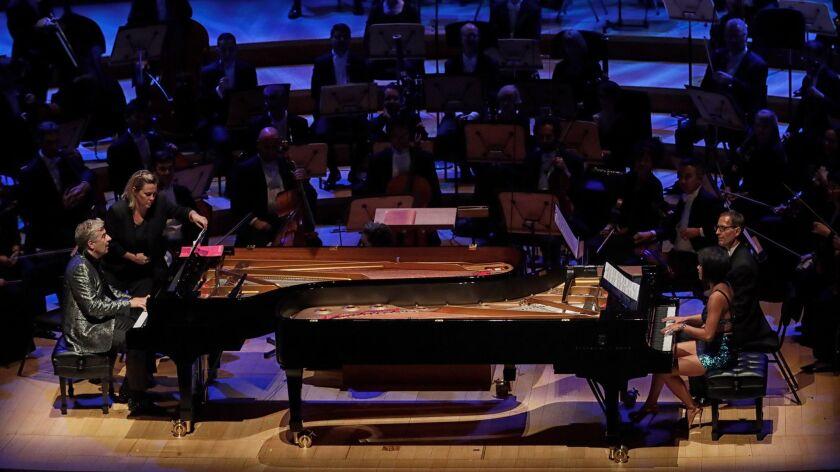 Pianists Jean-Yves Thibaudet and Yuja Wang perform an encore at the LA Phil gala.