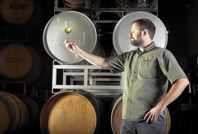 Winemaker Graham Tatomer inspects a glass of Riesling at his Tatomer Wines in Santa Maria, Calif.