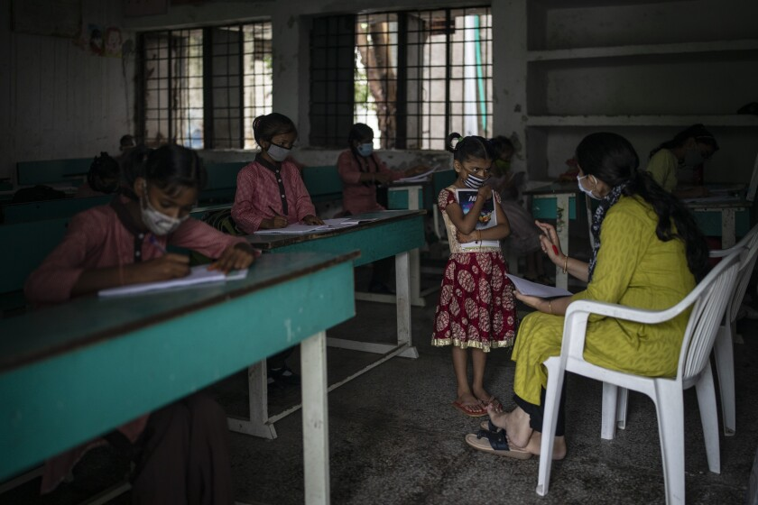 Students at desks in a classroom