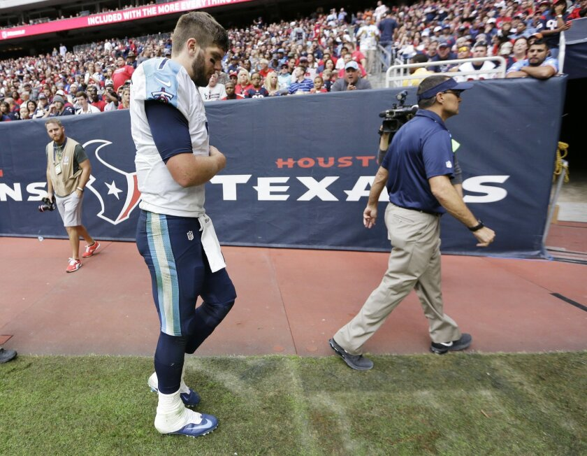 Tennessee Titans' Zach Mettenberger walks off the field after being hurt during the second half of an NFL football game against the Houston Texans Sunday, Nov. 30, 2014, in Houston. (AP Photo/David J. Phillip)