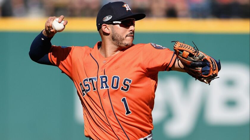 Carlos Correa of the Houston Astros throws to first base in the fourth inning against the Cleveland Indians during Game 3 of the ALDS.