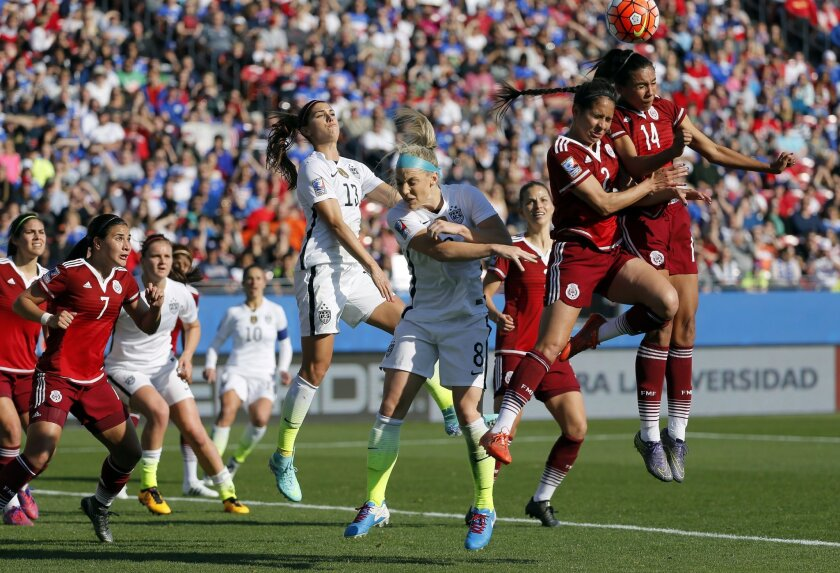 Mexico defender Annia Mejia (14) and Arianna Romero (2) combine to clear a United States corner kick away from United States' Julie Johnston (8) and Alex Morgan (13) in the first half of a CONCACAF Olympic qualifying tournament soccer match, Saturday, Feb. 13, 2016, in Frisco, Texas. The U.S. won 1