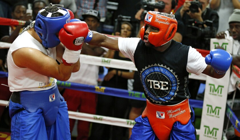 Floyd Mayweather Jr., right, works out at his gym on Wednesday in Las Vegas. Mayweather is scheduled to fight Andre Berto in a welterweight title bout next month.