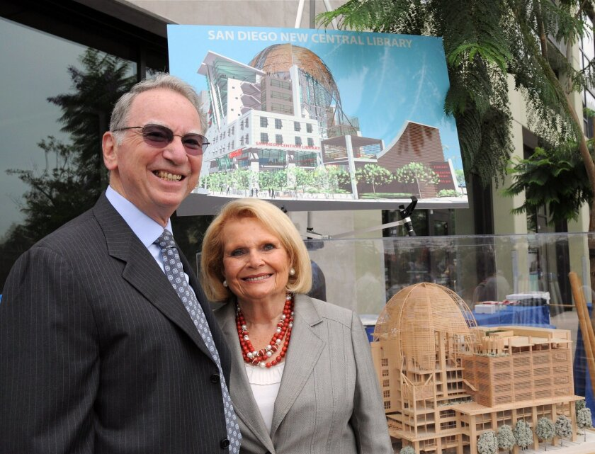 Irwin and Joan Jacobs next to the model of the Central Library as it was nearing completion.