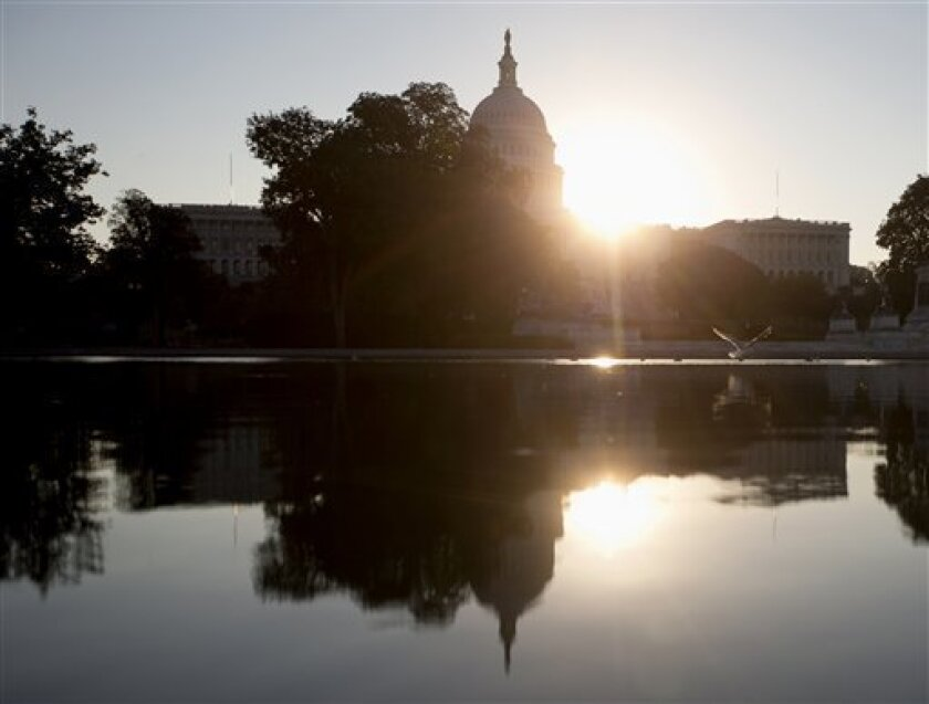 The sun rises behind the Capitol in Washington, Wednesday, Oct. 2, 2013. The political stare-down on Capitol Hill shows no signs of easing, leaving federal government functions _ from informational websites, to national parks, to processing veterans' claims _ in limbo from coast to coast. Lawmakers