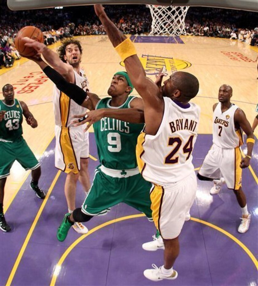 Boston Celtics guard Rajon Rondo (9) tries to shoot as he is guarded by Los Angeles Lakers' Pau Gasol, left, of Spain, and Kobe Bryant (24) during the first half of Game 2 of the NBA basketball finals Sunday, June 6, 2010, in Los Angeles. (AP Photo/Christian Petersen, Pool)