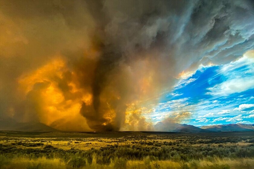A funnel appears in a thick plume of smoke from the Loyalton Fire in Lassen County, Calif., on Saturday.