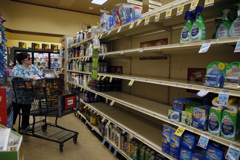 Hand sanitizer shelves are empty at a Pavilions supermarket in South Pasadena