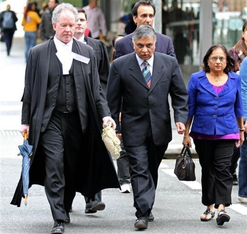 FILE - In this June 25, 2010 file photo, Dr. Jayant Patel, center, arrives at the Supreme Court in Brisbane, Australia, with his wife, Kishoree, right, and his lawyer, Michael Byrne, as a jury deliberates charges on three counts of manslaughter and one count of causing grievous bodily harm to four patients. American doctor Patel, 60, was ordered into police custody Tuesday, June 29, 2010, until he is sentenced on Thursday after a jury returned guilty verdicts on all charges against him. (AP Photo/Tertius Pickard, File)