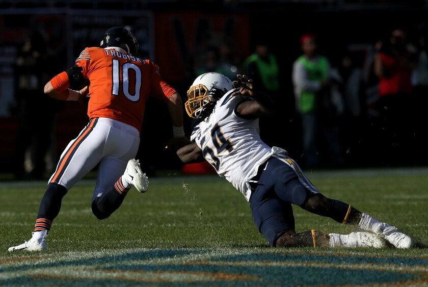 Chicago Bears quarterback Mitchell Trubisky is chased by a diving Chargers defensive end Melvin Ingram during the fourth quarter of the Chargers' 17-16 win Sunday.