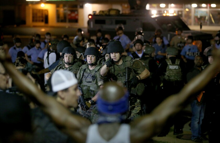 Police face off with demonstrators Aug. 19 in Ferguson, Mo.