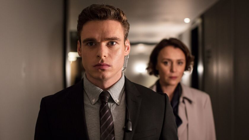 """(L-R) - Richard Maddenand Keeley Hawes in a scene from """"Bodyguard."""" Credit: Sophie Mutevelian/World"""