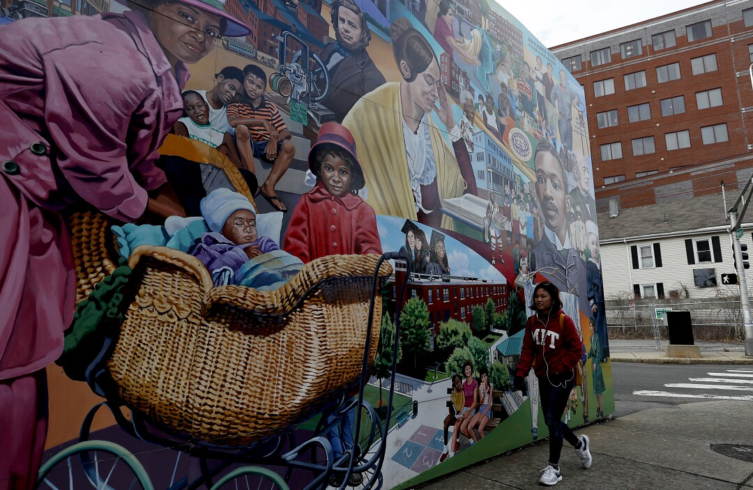 A mural depicts the history of the Port section of Cambridge, where construction fueled by high-tech startups in Kendall Square is changing the makeup of a historically black area.