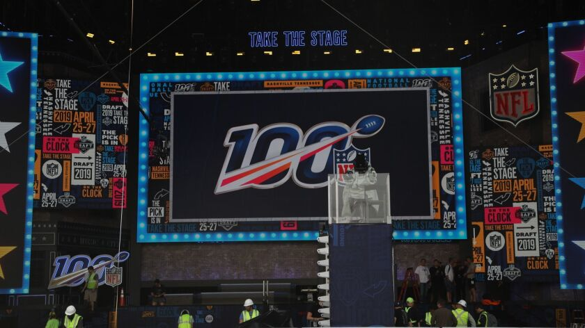 Crews set up stage for NFL Draft on Tuesday, April 23, 2019 in Nashville, Tenn. (AP Photo/Vera Nieuw