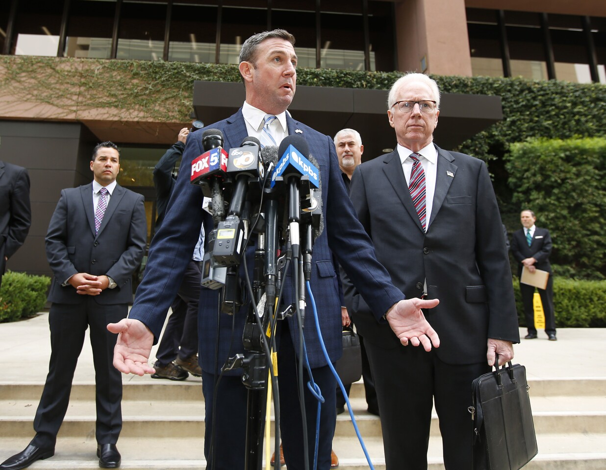 Rep. Duncan Hunter, R-Alpine speaks outside federal court in San Diego after pleading guilty in a yearlong campaign finance investigation on Dec. 3, 2019.