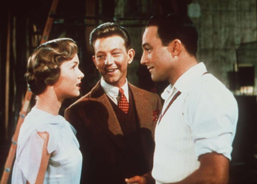 """The stars of """"Singin' in the Rain,"""" from left, Debbie Reynolds, Donald O'Connor and Gene Kelly."""